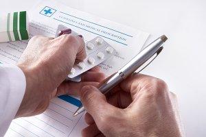Doctor writing down prescription