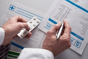 Doctor showing blood test report top