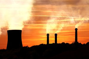 Power generating factories at sunset