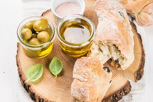 Fresh ciabatta bread and olives