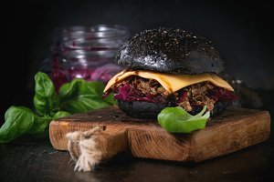 Black burger with stews