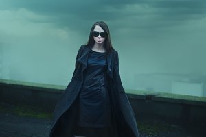Girl on the roof in the Gothic style