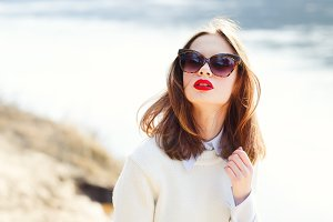 girl with red lips and sunglasses