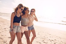 Young friends walking along a beach