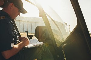Pilot checking the flight manual