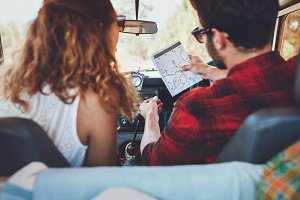 Young couple checking a map