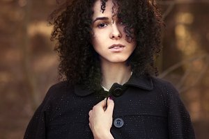 curly-haired girl in the park
