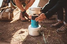 Woman camper warming her hands