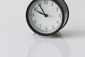 Alarm clock on white background, minimalism