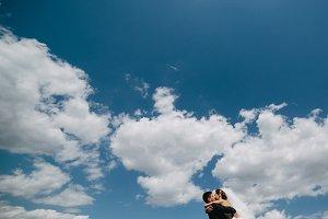 couple on blue sky background