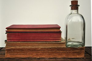 bottle and ancient books