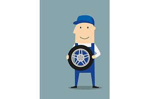Happy car mechanic with wheel