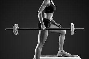 Woman workout with barbell