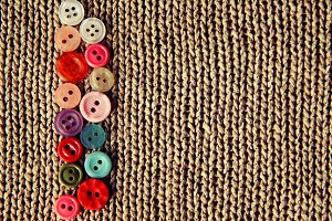 Buttons on knitted background
