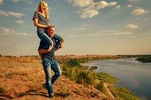 Man carrying girl on piggyback.