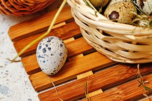 Quail eggs in a basket. Easter.