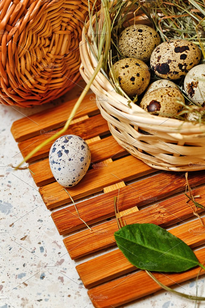 Quail eggs in a basket. Easter. - Food & Drink