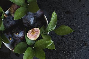figs with leaves on a black, selective focus
