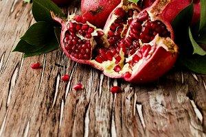 Fresh pomegranates, selective focus