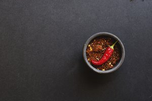 bowl with spices and hot pepper, selective focus