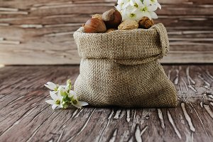 canvas bag with nuts on a wooden table