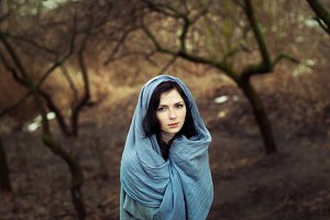 girl in a scarf in the woods