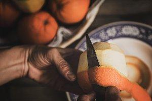 Person peels an orange