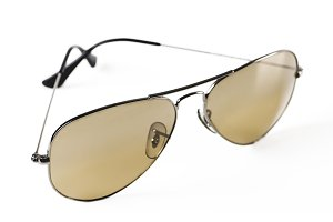 Modern sunglasses on white background