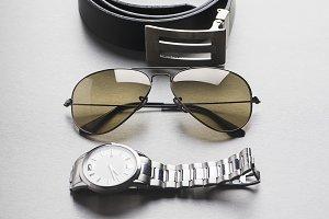 Belt, sunglasses and watch