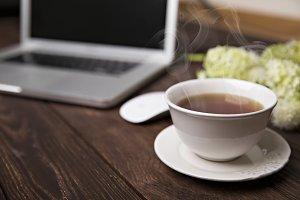 Hot tea on the desk
