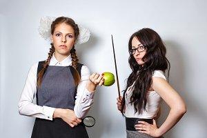Teacher with pointer. Schoolgirl.
