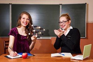 Teacher praises student. Chemistry