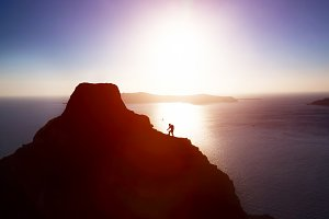 Silhouette of climbing man.
