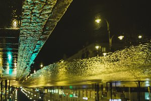 Night city in puddle reflection
