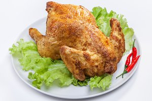 baked chicken with green salad and c