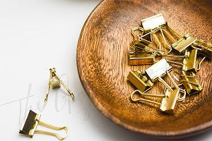 Gold Clips in Wooden Bowl
