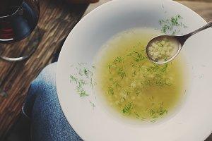 Man holding soup minestra