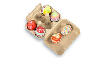 Colorful Easter egg in pulp box