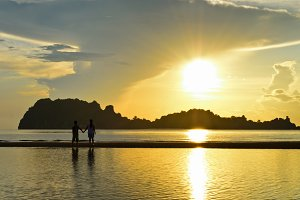 Children on beach in sunrise