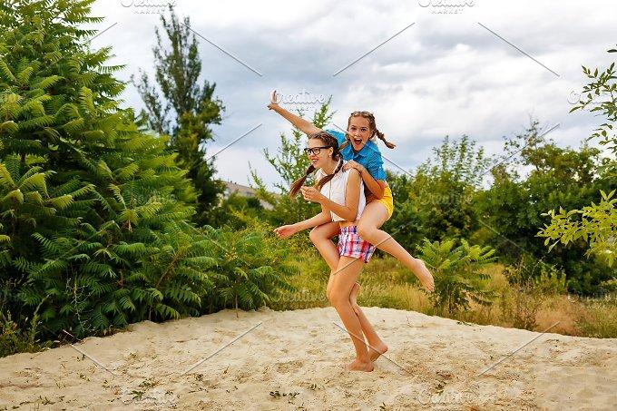 Best friends have fun. Piggyback - People