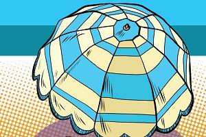 Girl under a beach umbrella