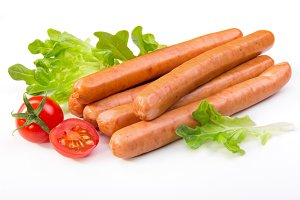 Sausages with lattice and tomatoes