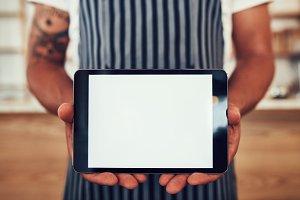 Waiter holding a digital tablet