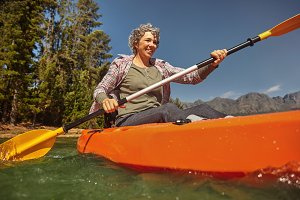 Senior woman canoeing