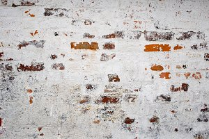 Red brick wall with white lime
