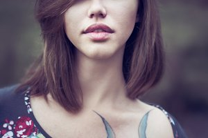 girl with big lips and tattoos