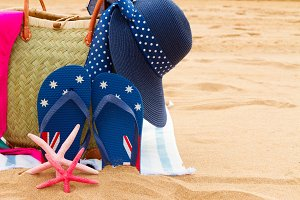 sunbathing accessories on sandy beach