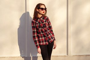 young girl in a plaid shirt