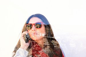 woman calling by phone in a village