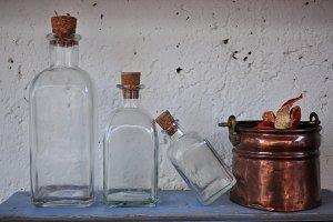 bottles and copper cauldron